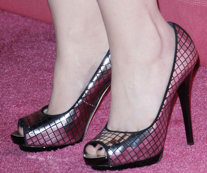 Michelle Trachtenberg wearing metallic peep-toe pumps