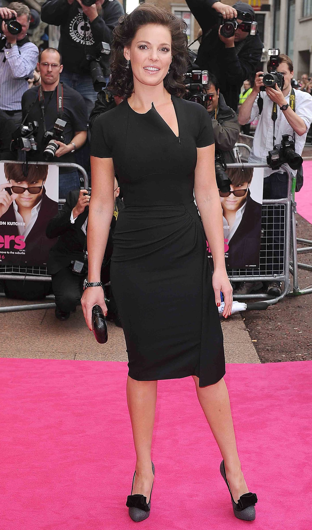 Katherine Heigl flaunts her legs in a black Victoria Beckham Fall 2010 dress and Christian Louboutin 'Lady Page' heels at the European Premiere of 'Killers'