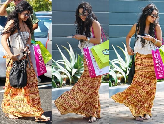 Vanessa Hudgens in a boho-look dress texting on her Blackberry cellphone