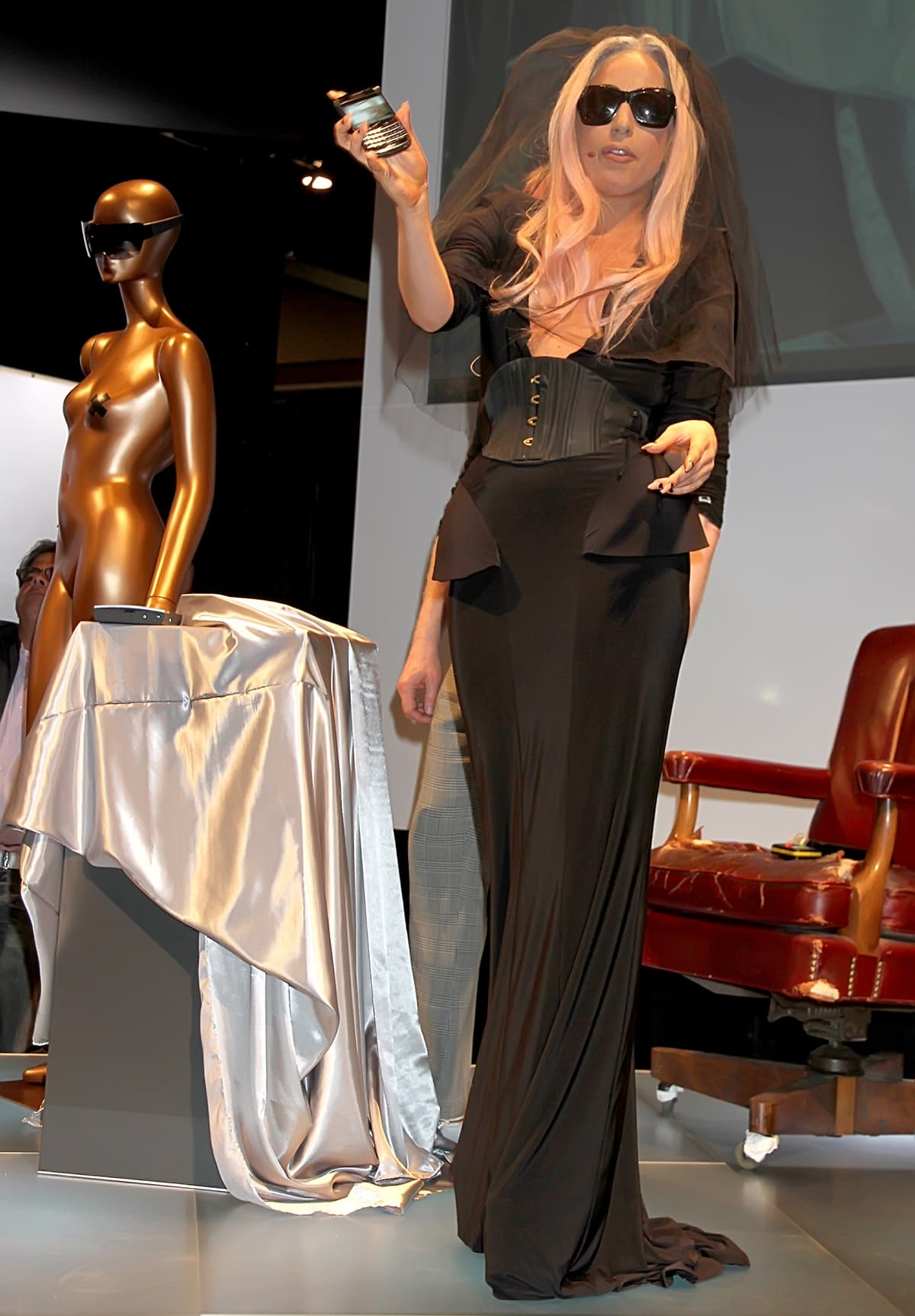 Lady Gaga styled a black Sally LaPointe Spring 2011 jersey dress with matching sunglasses and a veil