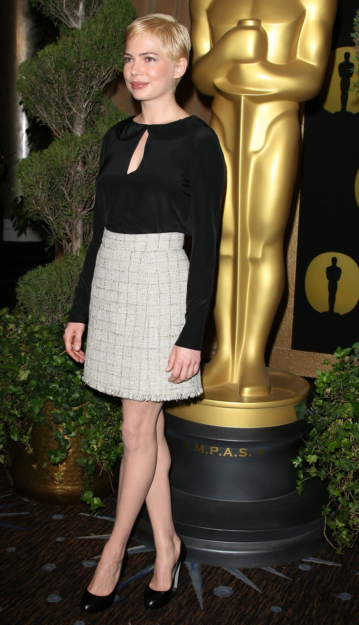 Michelle Williams shows how to wear a black silk blouse with a tweed skirt