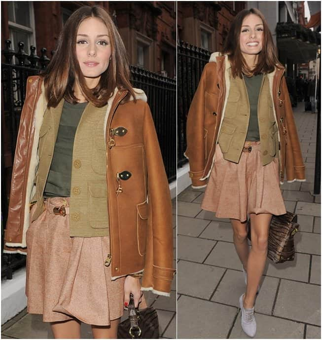 Olivia Palermo styled a muted pink skirt with an olive green blouse