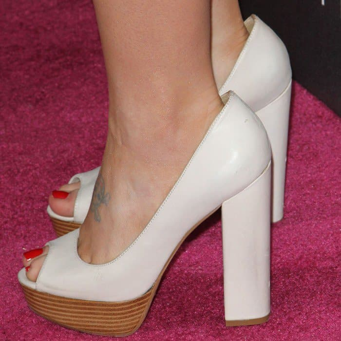 Kelly in white classic peep toe pumps from Aldo