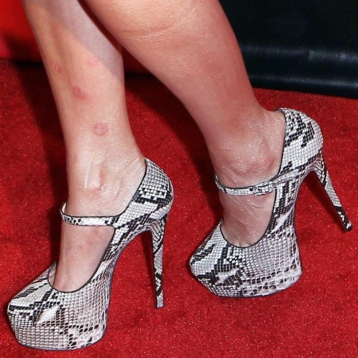 Kim Kardashian's feet in python Christian Louboutin heels