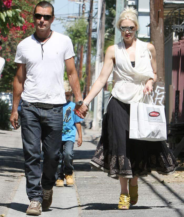 Gwen Stefani was looking unconventionally fashionable in a white wrap top paired with an ankle length black skirt and yellow bootie sandals