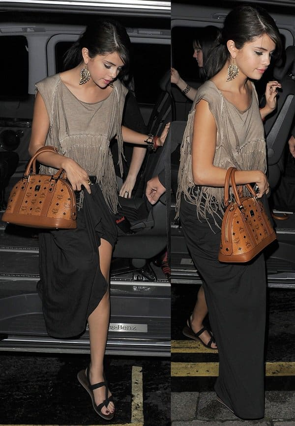 Selena Gomez looking boho chic in a fringe-detailed blouse and a maxi skirt