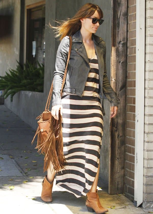 Olivia Wilde arrives for lunch at Little Dom's Cafe in Los Feliz. The actress looked very stylish in a denim jacket, striped maxi-dress and accompanied with a tasseled tan leather satchel in Los Feliz, California on August 18, 2011