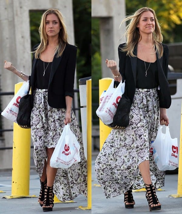 Kristin Cavallari kept it simple but chic by wearing an asymmetrical skirt that she then topped with a blazer and capped off with ankle high gladiator heels