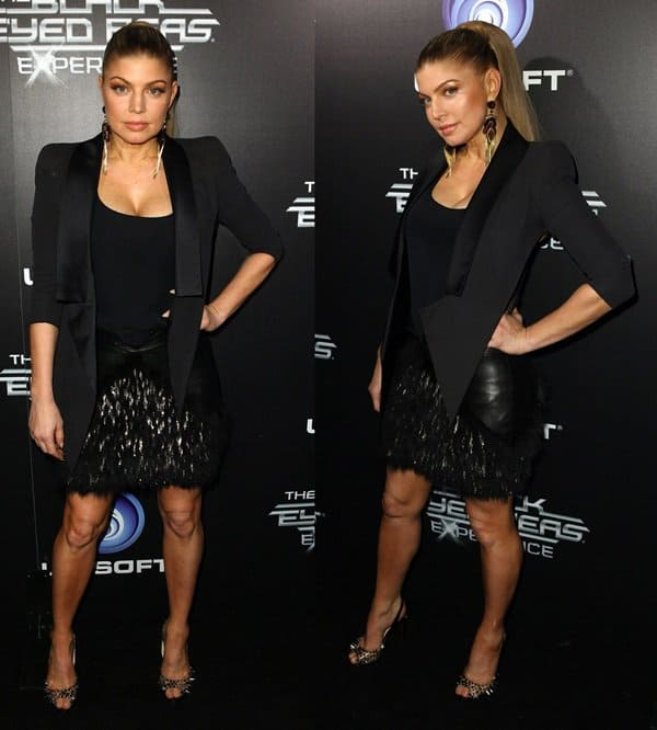 Fergie flaunts her legs in a black leather-trimmed fringed skirt