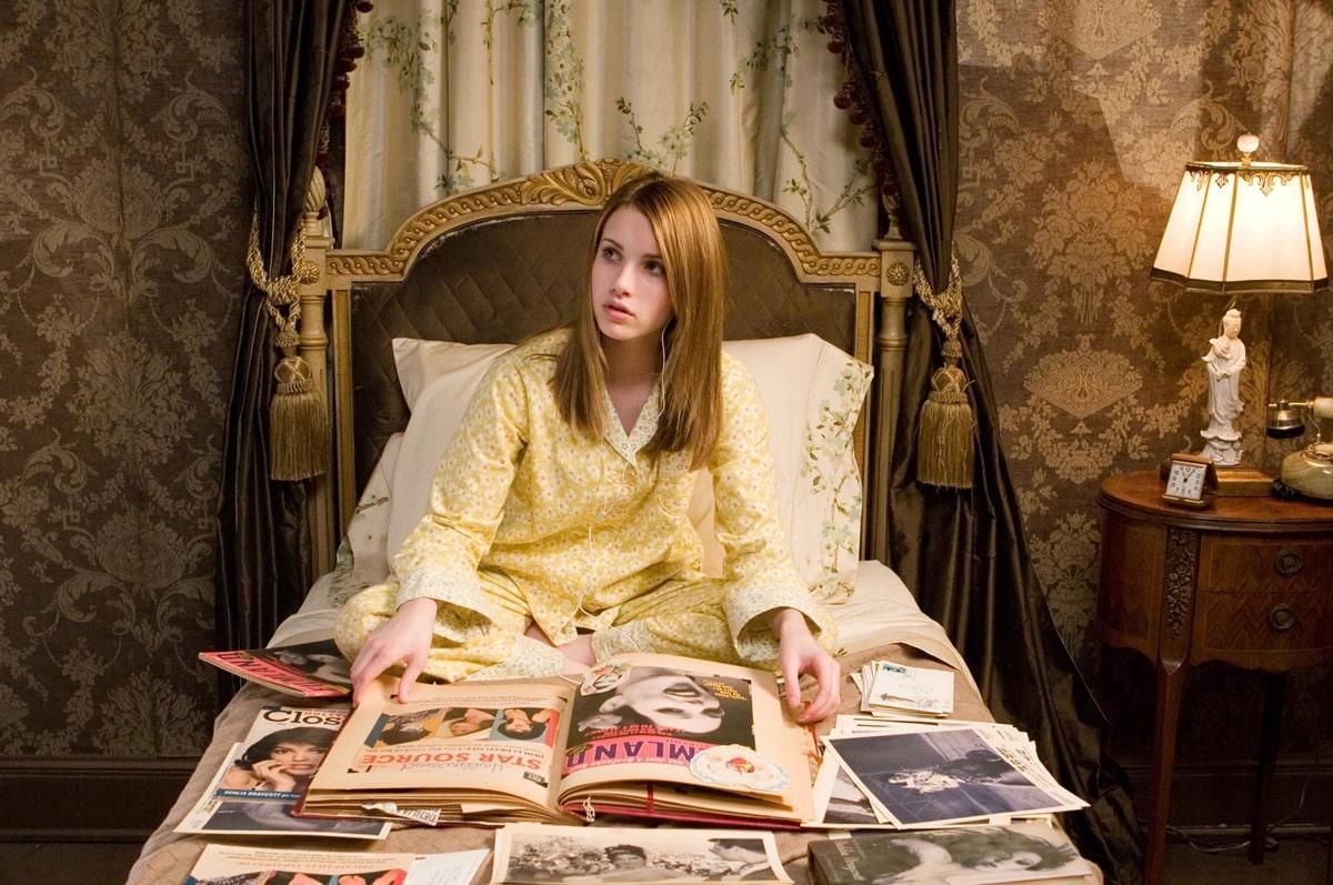 Emma Roberts wears pajamas in bed as teen detective Nancy Drew
