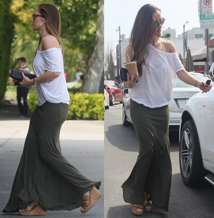 Minka Kelly wore a loose white top matched with an army green-colored maxi skirt, which perfectly complimented her sun-kissed skin tone