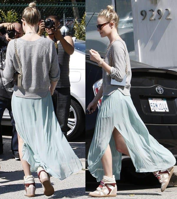 Kate Bosworth donned a beautiful minty sea-foam pleated maxi skirt with a soft raglan sweatshirt in a neutral grey tone