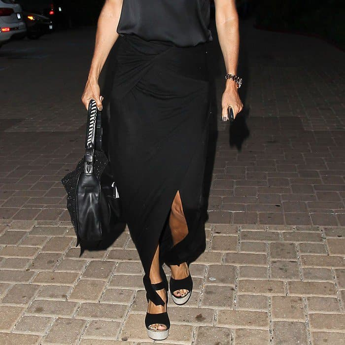 A detailed look at Courteney Cox's black asymmetrical skirt that she wore on July 6, 2012