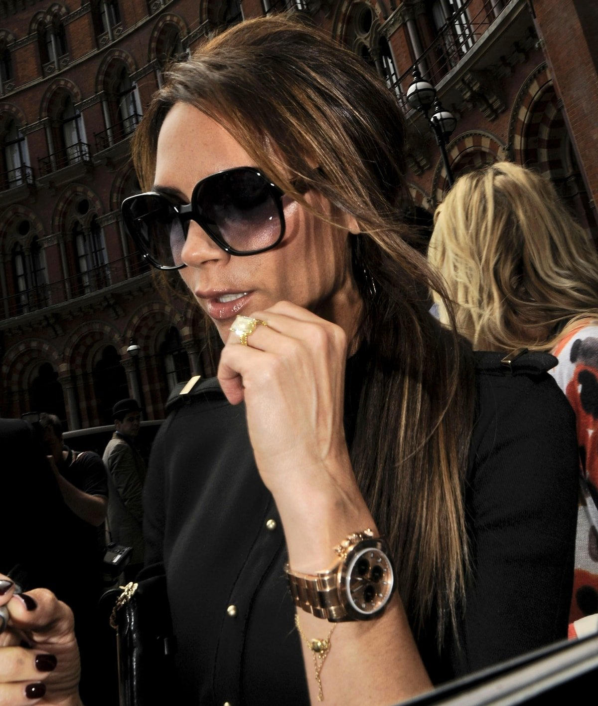 Victoria Beckham shows off her Rolex Day-Date Presidential wristwatch with champagne stick dial