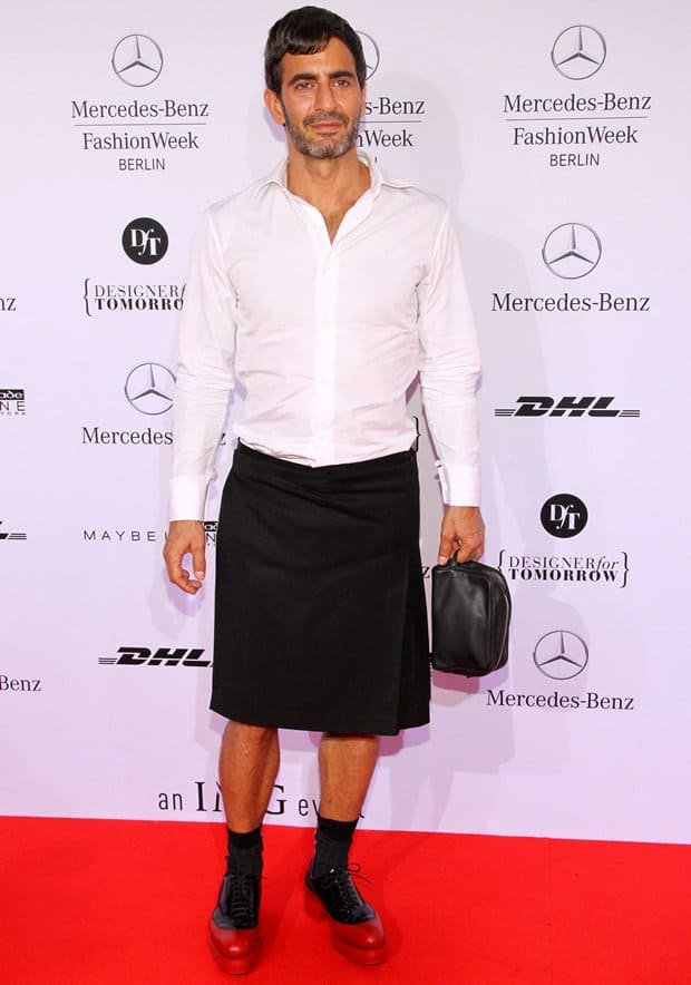 Marc Jacobs wearing a white button-down shirt and a black A-line knee-length skirt