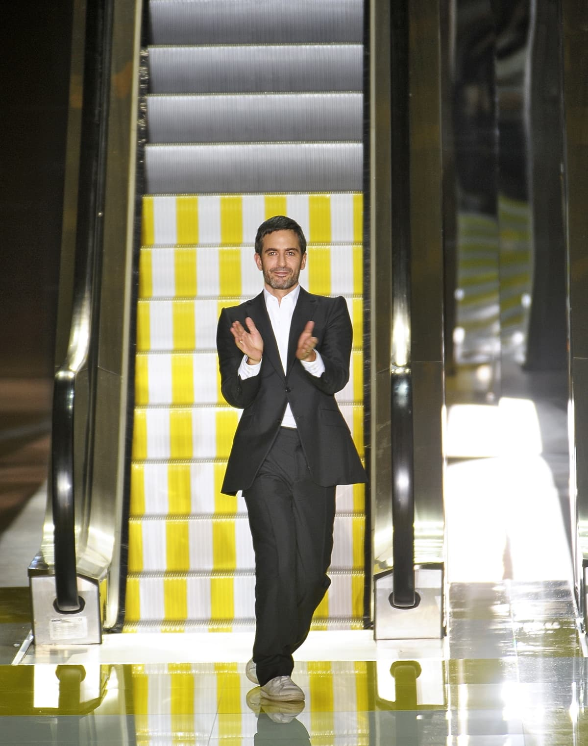 Fashion designer Marc Jacobs acknowledges the applause of the audience after the Louis Vuitton Spring/Summer 2013 show
