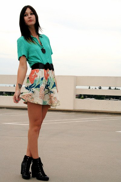 Disarming Darling wearing a floral skirt
