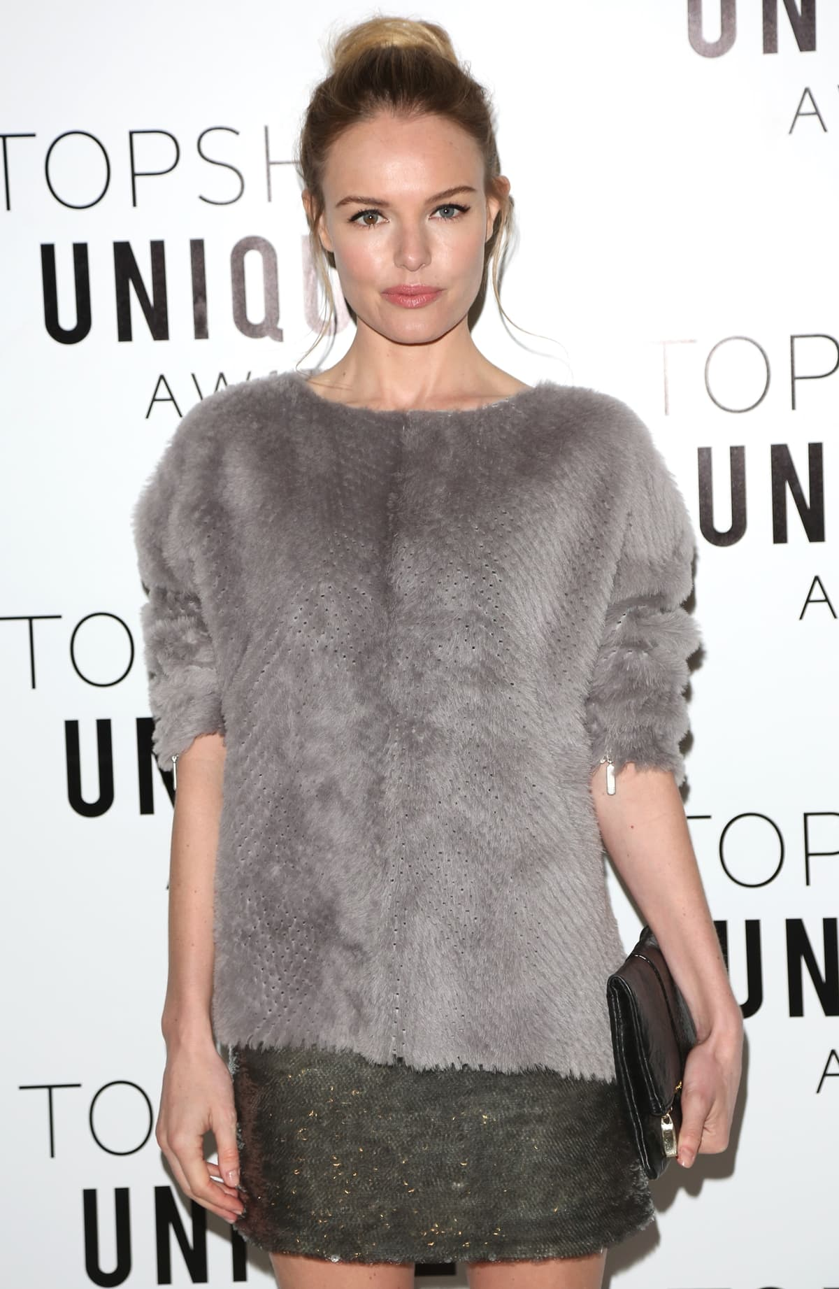 Kate Bosworth wears a sparkly mini skirt with a nice, warm sweater