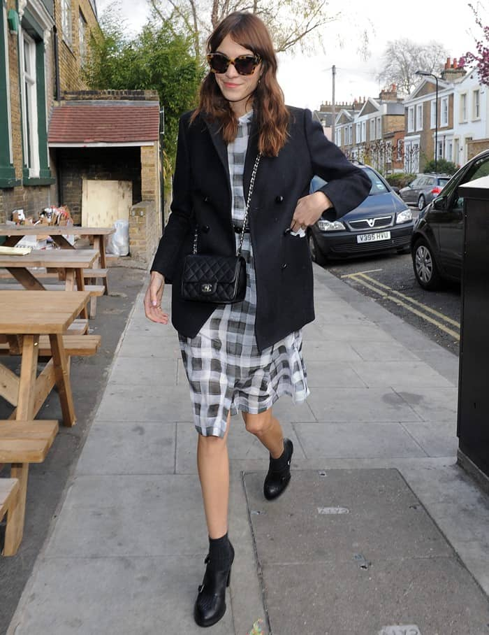 Alexa Chung wearing an adorable gingham dress from Paul Smith Black Label