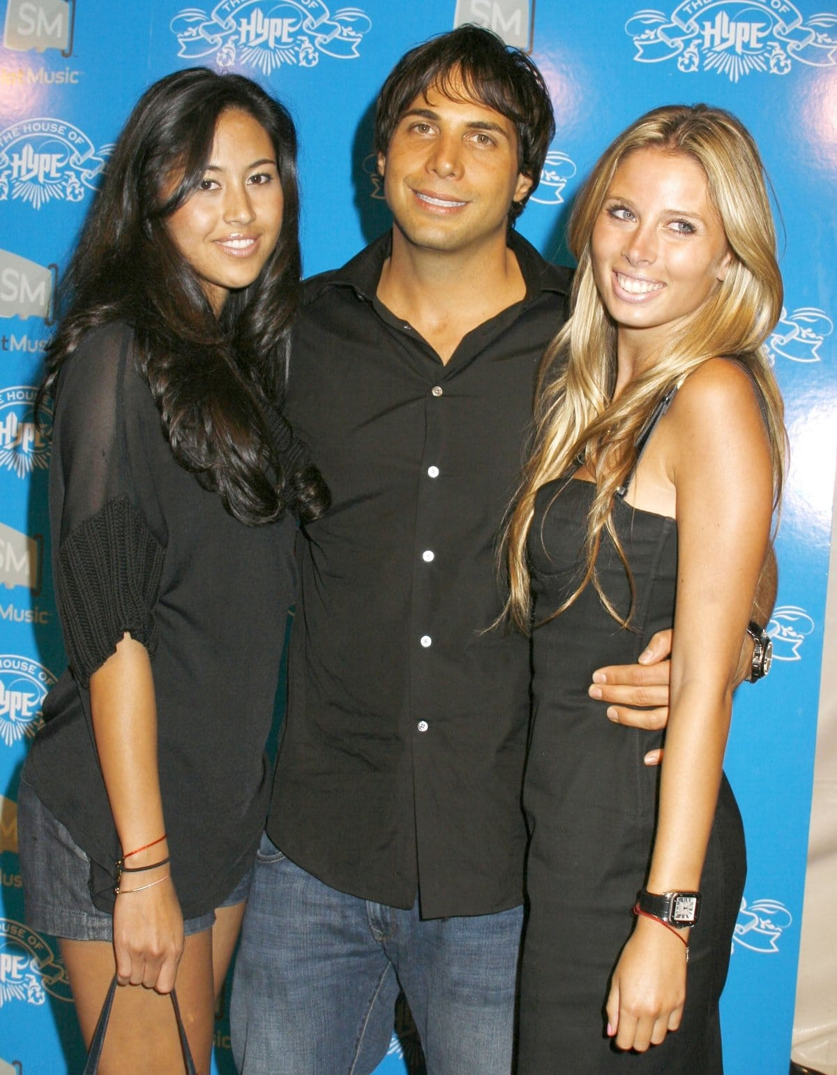 Joe Francis and two beautiful female guests arrive at the House of Hype Pre-Awards Party