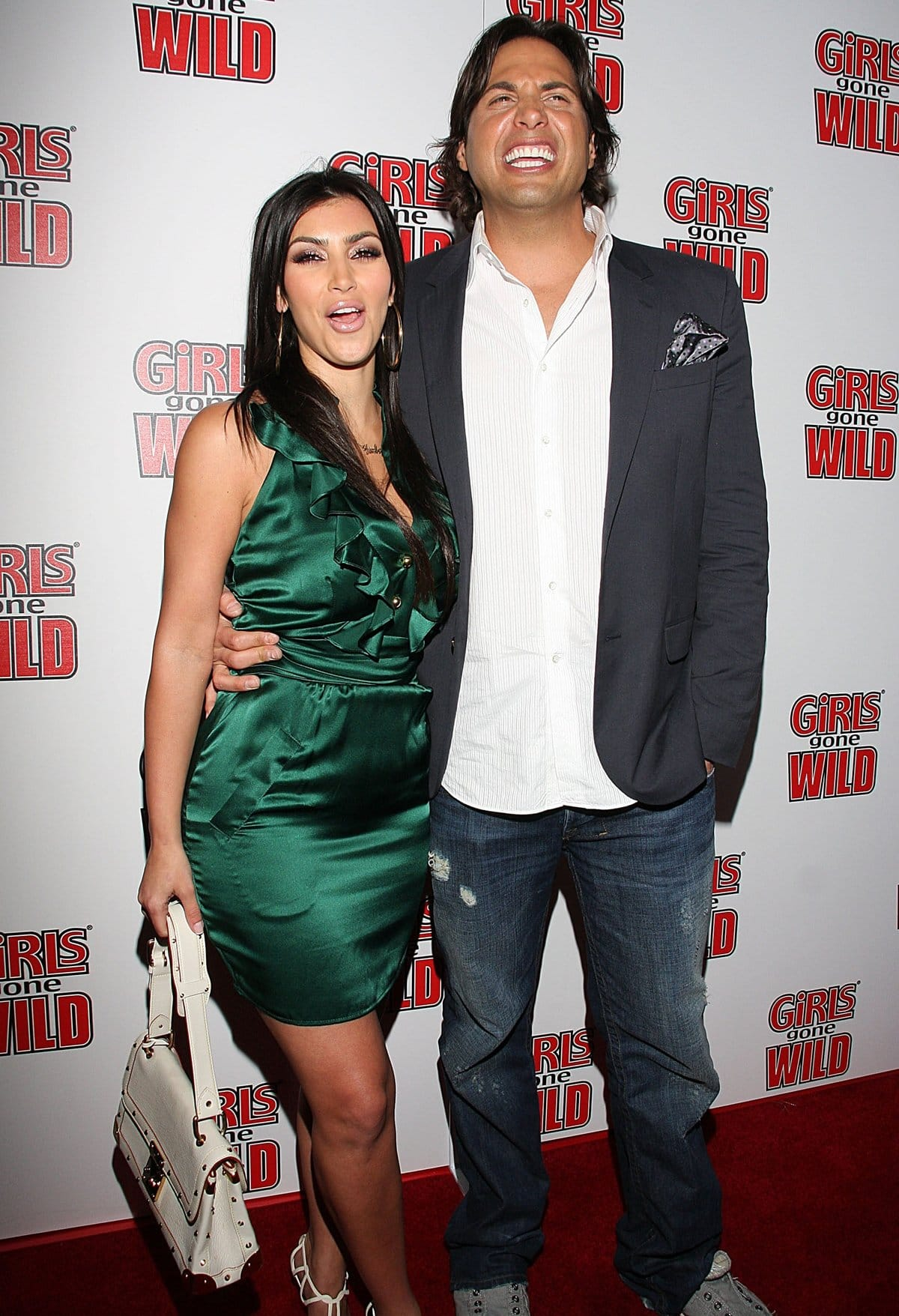 Kim Kardashian and her good friend Joe Francis attend the launch party for Girls Gone Wild Magazine