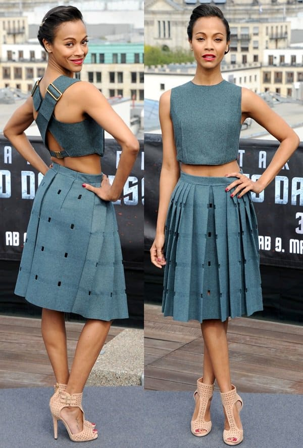 Zoe Saldana sported a Calvin Klein ensemble featuring a matching cropped top and a pleated skirt