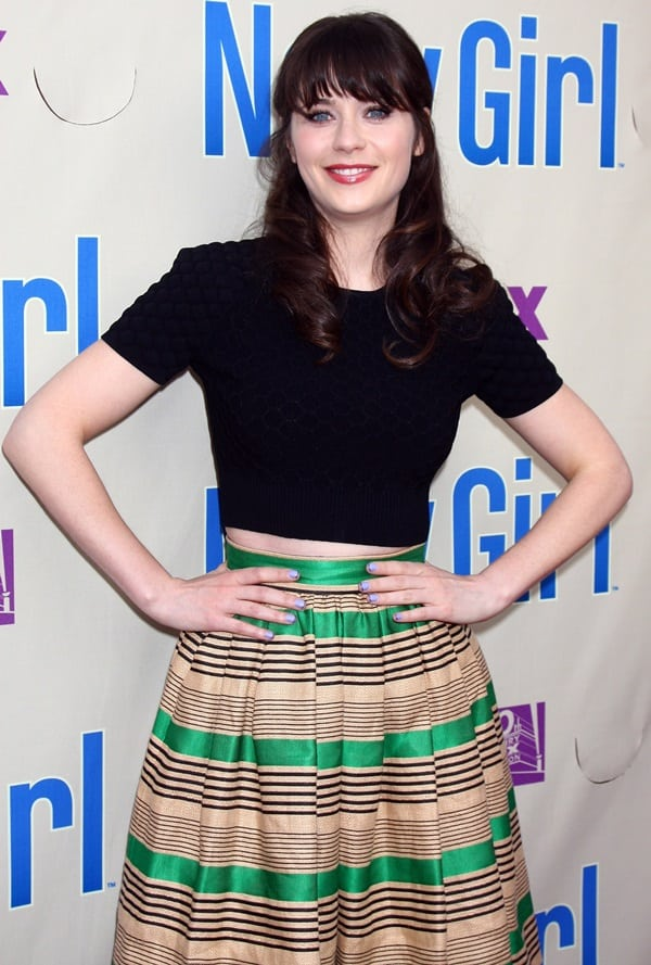 Zooey Deschanel a striped skirt with a plain black tee, black leggings, and pumps