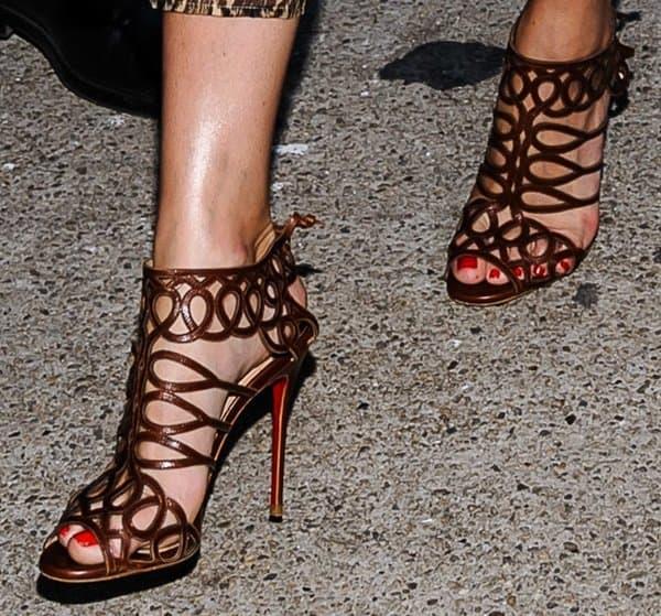 Olivia Palermo wearing Christian Louboutin's 'Zigouwi' sandals