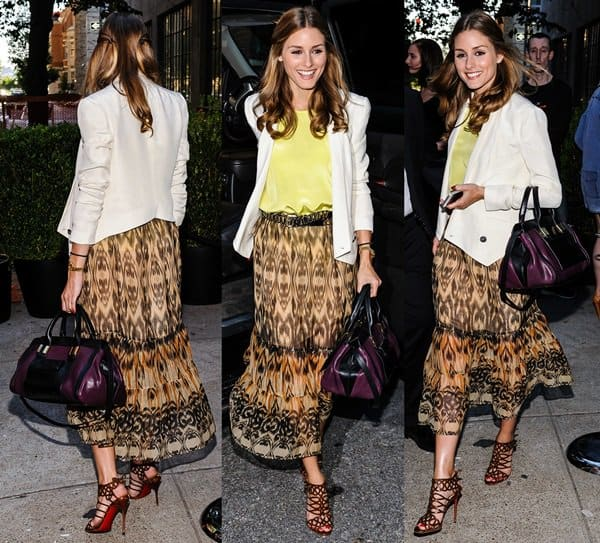 Olivia Palermo's outfit consisted of a white tailored blazer worn over a yellow blouse, which she paired with a tribal-printed maxi skirt