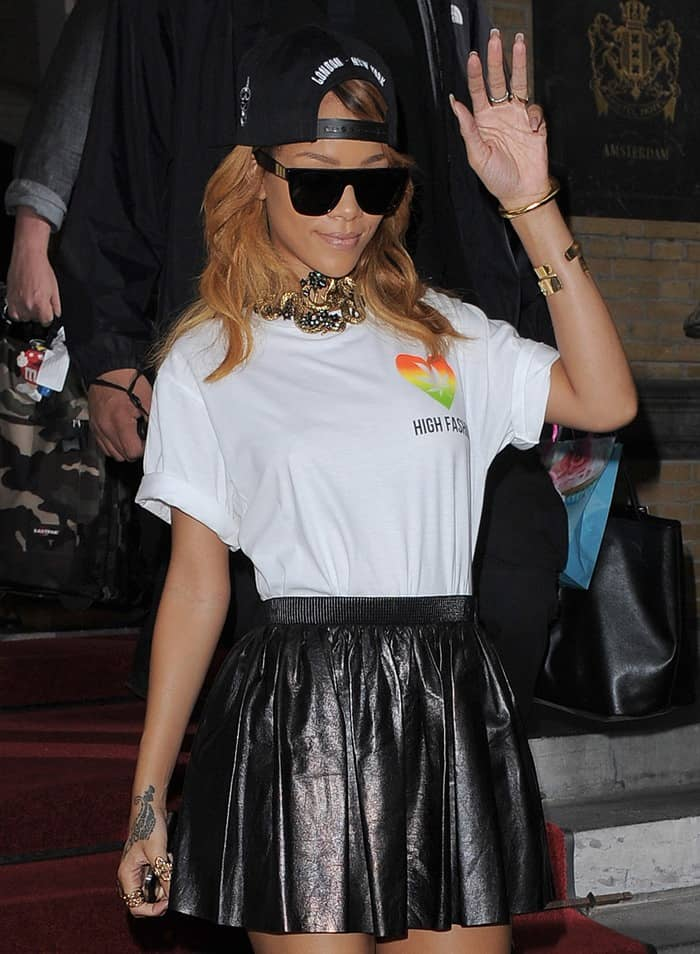 Rihanna leaving her hotel in a pleated leather Miu Miu skirt to perform at the Ziggo Dome in Amsterdam on June 24, 2013