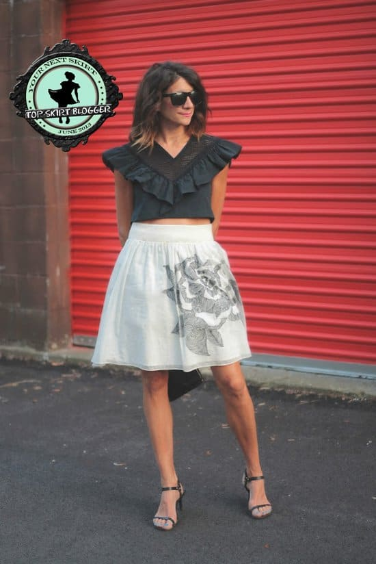 Sheree styled a black ruffled crop top with a rose print skirt and black sandals