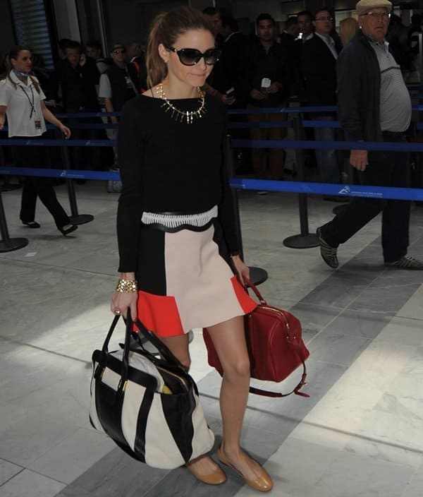 Olivia Palermo wearing Zara's color block combination skirt