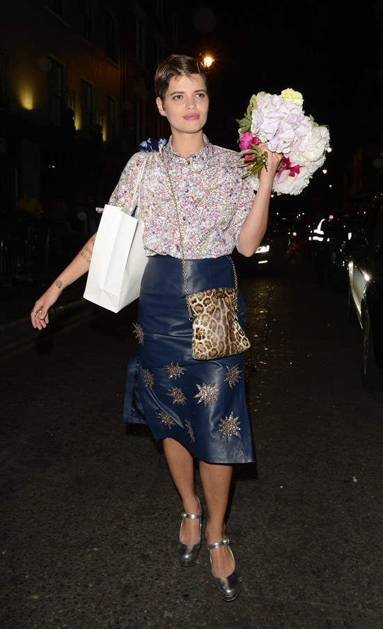 Pixie Geldof holding a bouquet of flowers as she leaves The Groucho Club, London on July 4, 2013