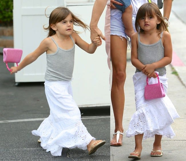 Anja Louise Ambrosio Mazur in a gray tank top paired with a flowy white peasant maxi skirt
