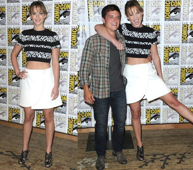 Jennifer Lawrence poses with co-star Josh Hutcherson at the Comic-Con International 2013 - 'The Hunger Games: Catching Fire' Photo Call in San Diego on July 20, 2013