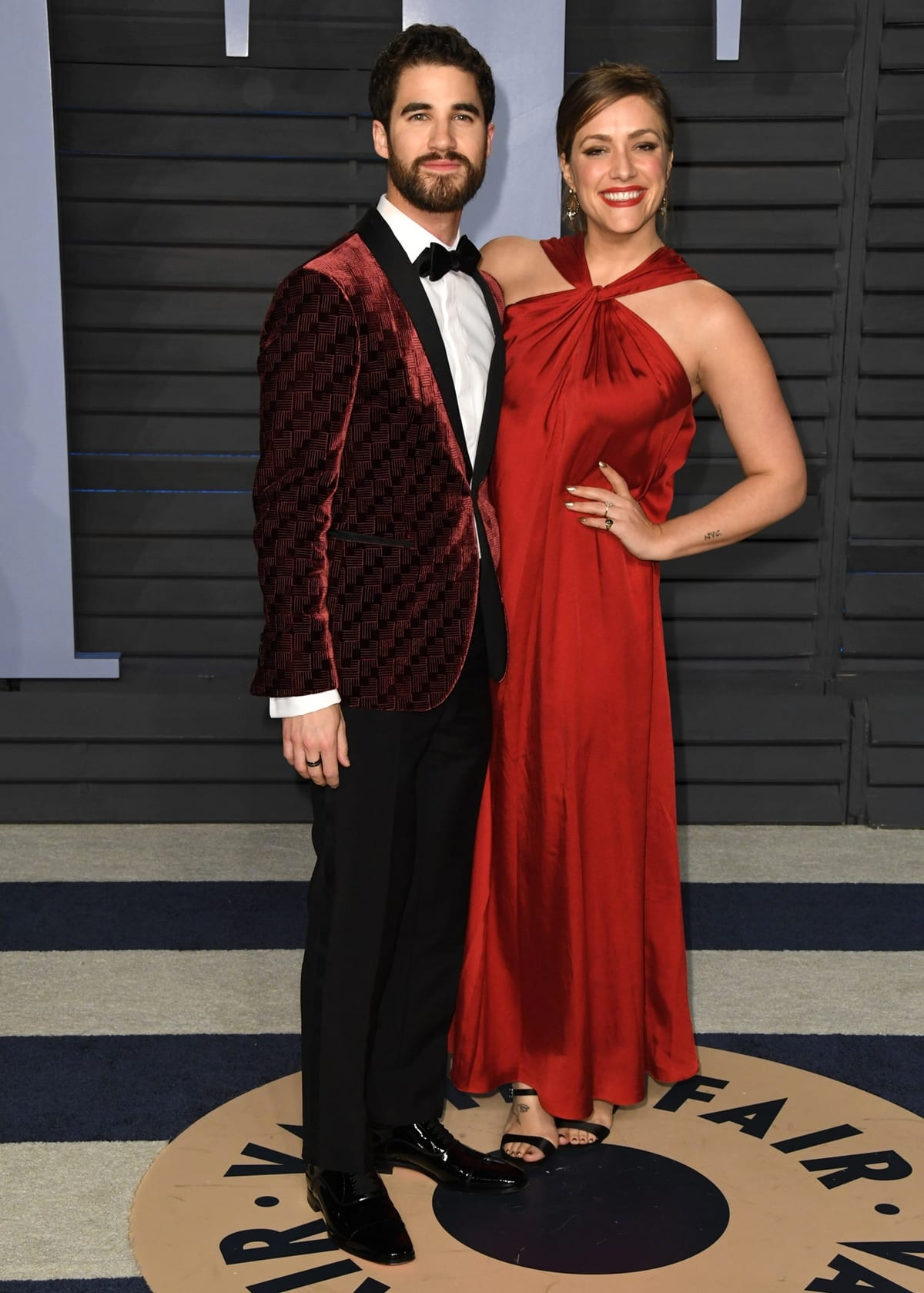 Wearing an Armani suit and Christian Louboutin shoes, Darren Criss and Mia Swier attended the 2018 Elton John AIDS Foundation's Academy Awards Viewing Party