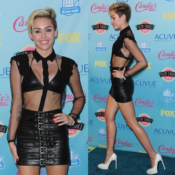Miley Cyrus snaps a few pictures at the 2013 Teen Choice Awards Press Room at the Gibson Amphitheatre in Los Angeles on August 11, 2013
