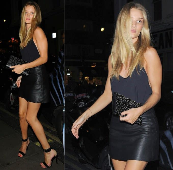 Rosie Huntington-Whiteley looked completely gorgeous in an all-black ensemble consisting of a black cami top and leather mini skirt by Zadig & Voltaire