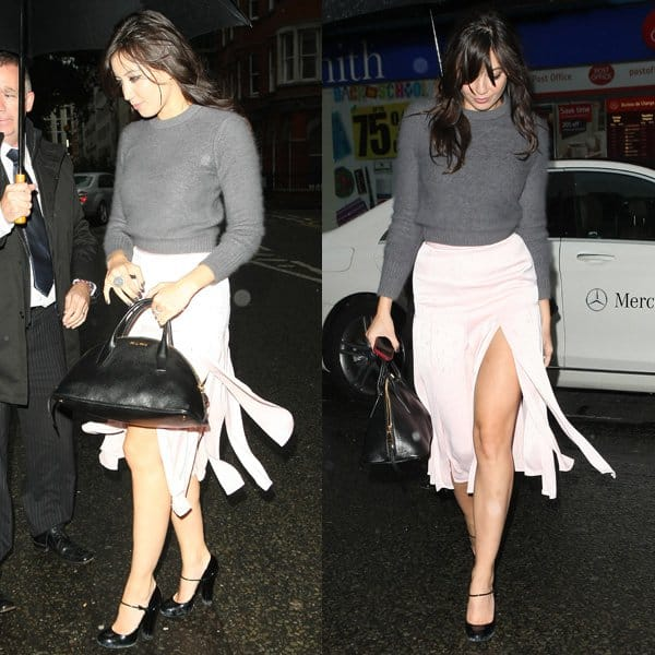 Daisy Lowe paired her skirt with a fuzzy grey knit sweater
