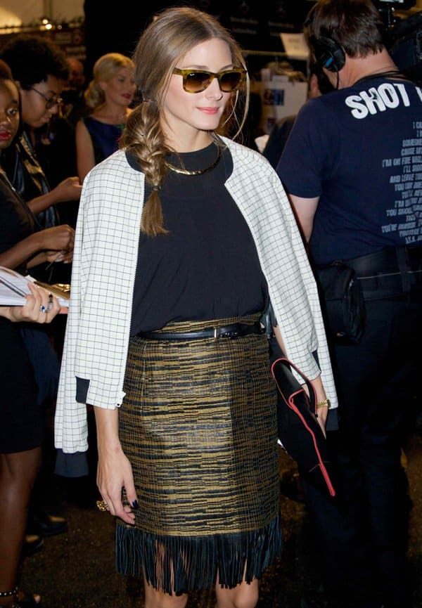 "Olivia Palermo concluded her look with a white Tibi ""Tatersol"" jacket, a red-trimmed leather envelope clutch from Reiss, zebra-print heels from Giuseppe Zanotti, and a pair of Ray-Ban tortoiseshell sunnies."