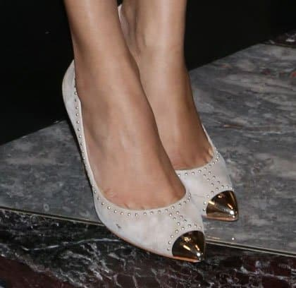 Freida Pinto wearing pointed metal-toe-capped suede heels with studs