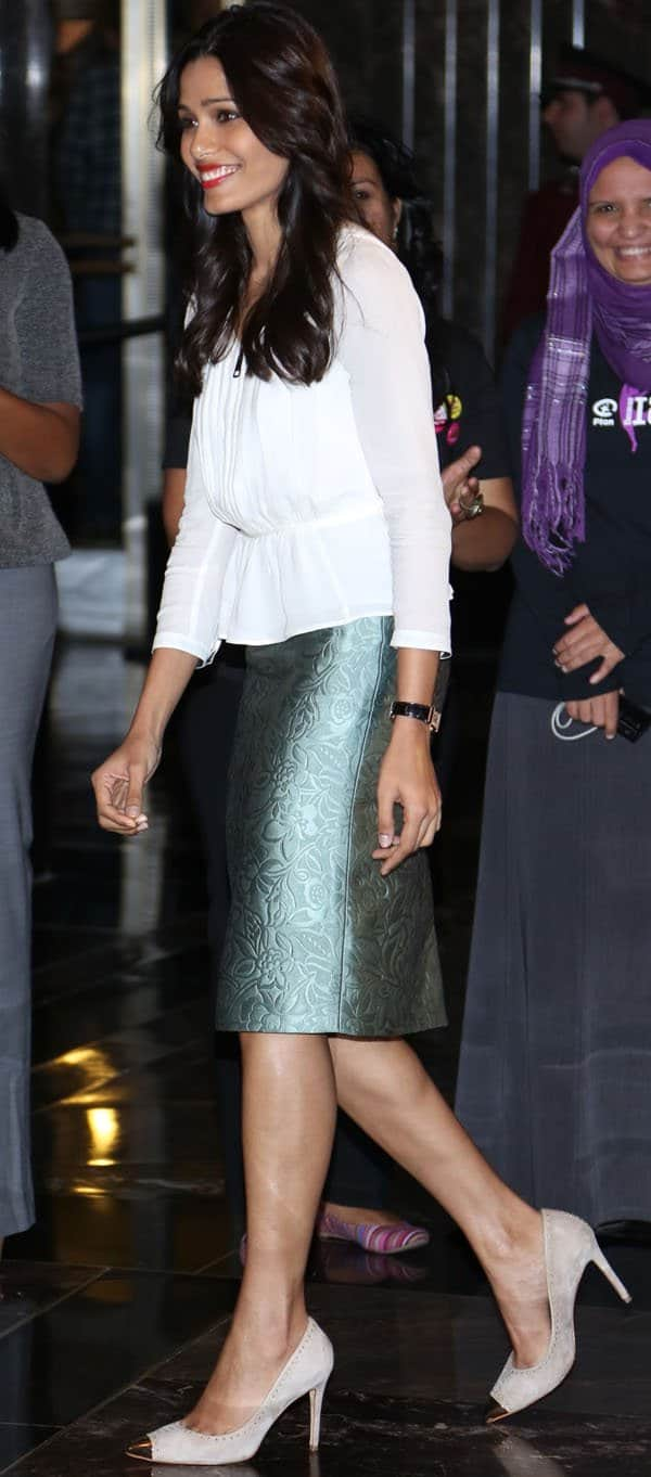 Freida Pinto was a mix of chic sophistication and dead-on business in her green pencil skirt, which she styled with a three-quarters-sleeved white blouse and a pair of pointed metal-toe-capped suede heels with studs.