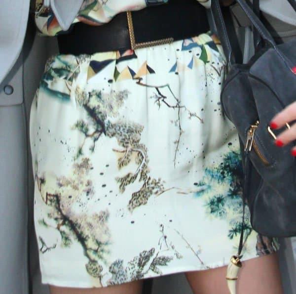 Miranda Kerr wearing an egyptian-print skirt by Balenciaga