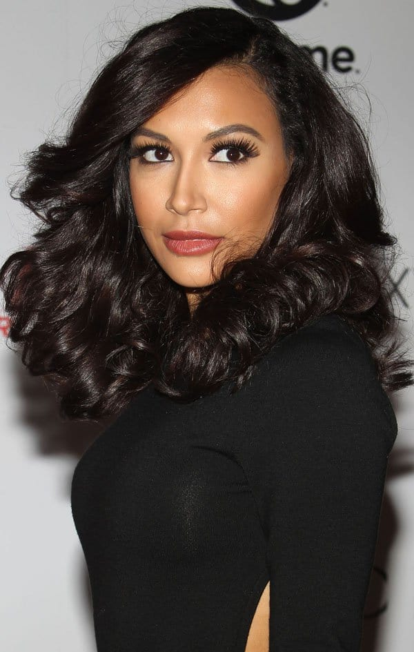 Naya Rivera sporting a Michael Kors long-sleeved black wool bodysuit with a sexy cutout back