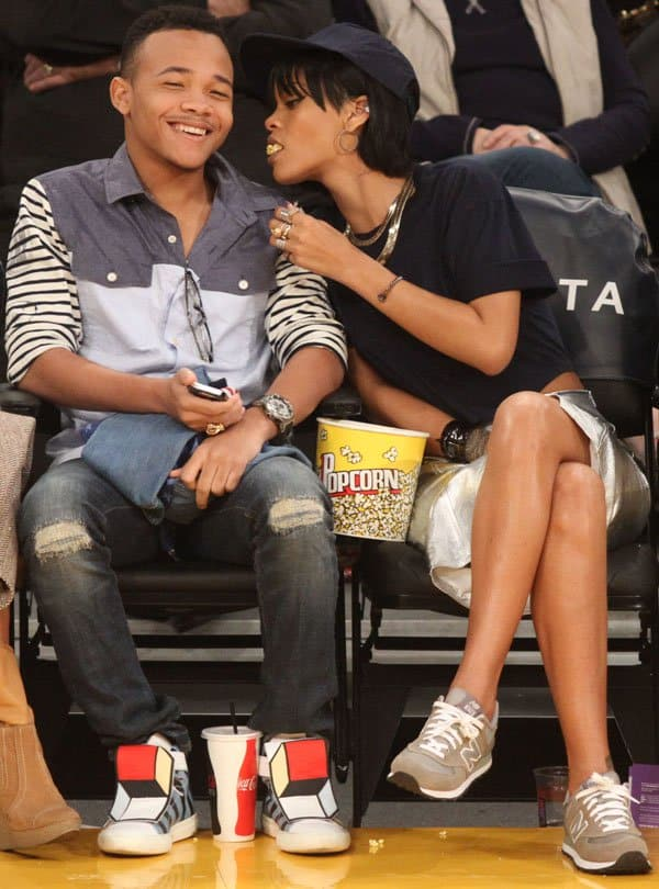 Rihanna (R) and her brother Rajad Fenty attend a basketball game between the Portland Trailblazers and the Los Angeles Lakers