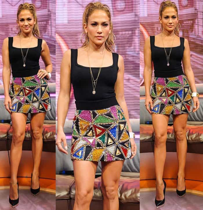 Jennifer Lopez showed off her mile-long legs and well-toned figure in a black sleeveless top and a Fausto Puglisi mini skirt