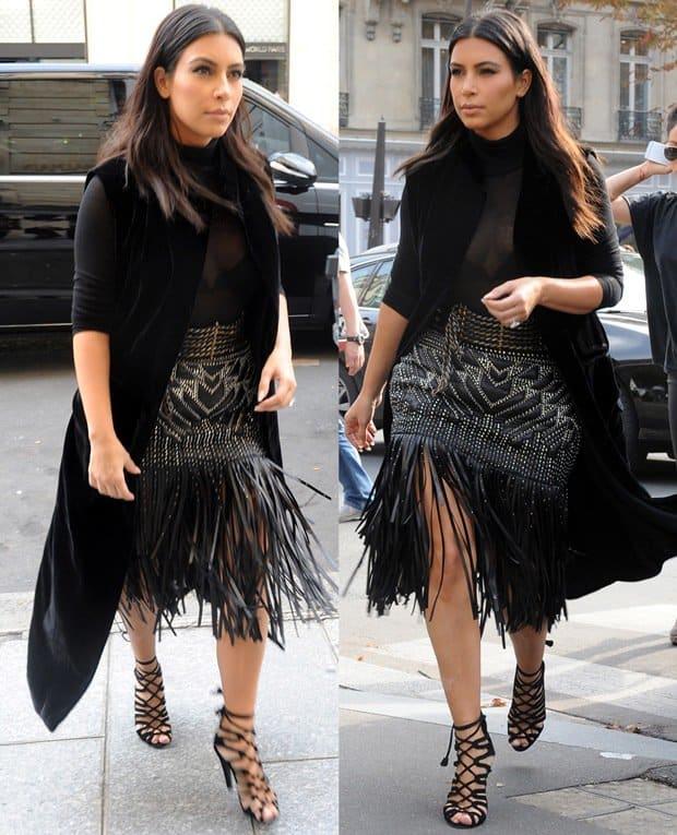 Kim Kardashian rocking a leather studded fringed skirt by Roberto Cavalli