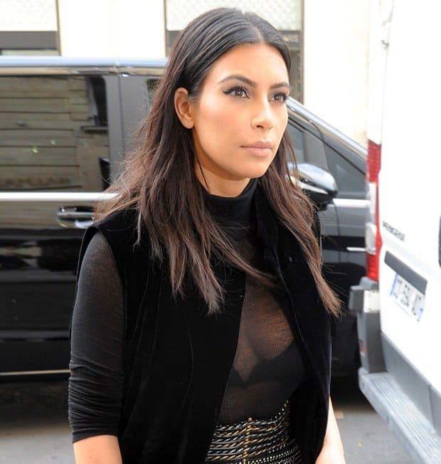 Kim Kardashian wearing a sheer top with a long velvet robe in Paris on September 29, 2014