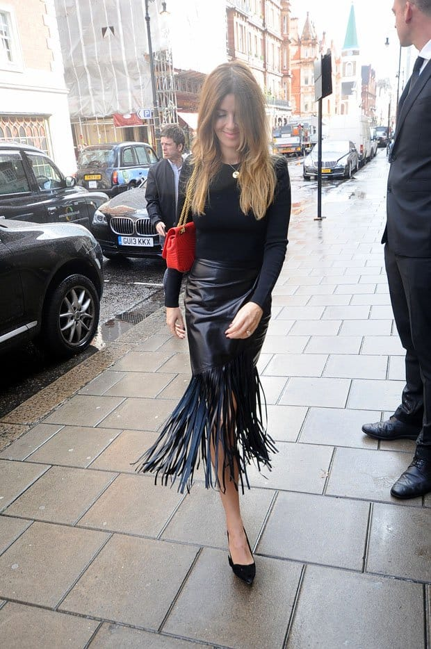 British model Sarah McDonald looking fabulous in a black fringed skirt and a fitted sweater