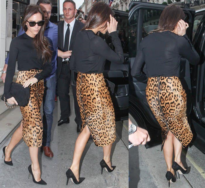 Victoria Beckham styled her leopard skirt with a plain black sweater, a pair of black pumps by Manolo Blahnik, a chain-accented bag, and black sunglasses